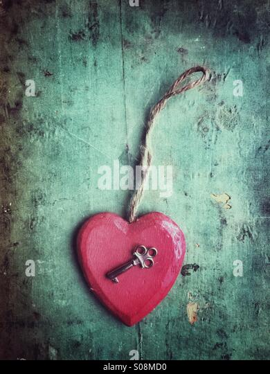 Red wooden heart and a key - Stock-Bilder