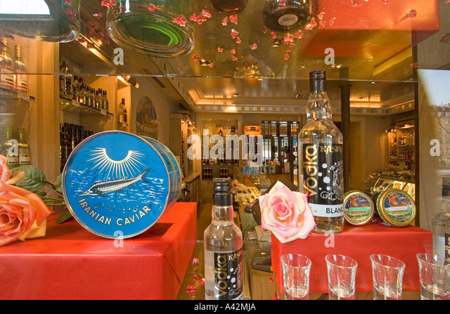 Paris France Place de la Madeleine Caviar house gourmet shop shop window with Caviar and wodka - Stock Image