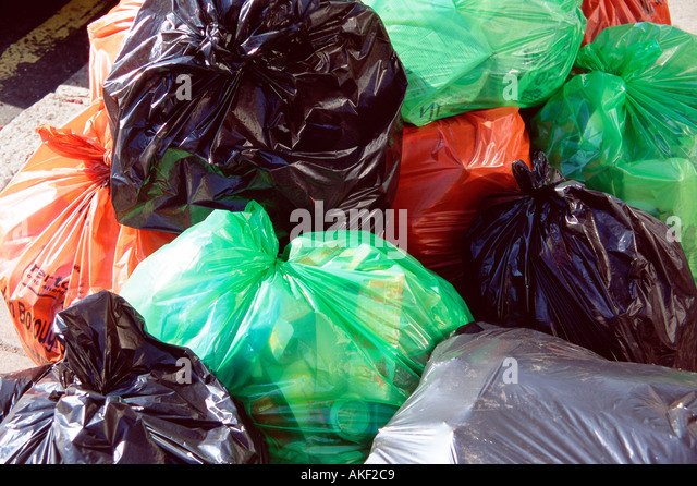 Rubbish bags left for collection - Stock Image