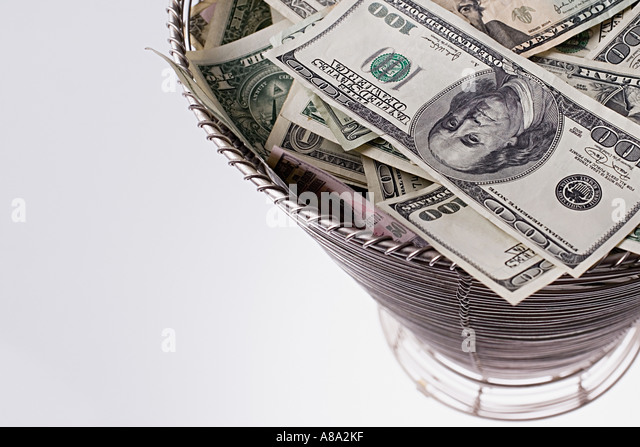 Basket full of banknotes - Stock Image