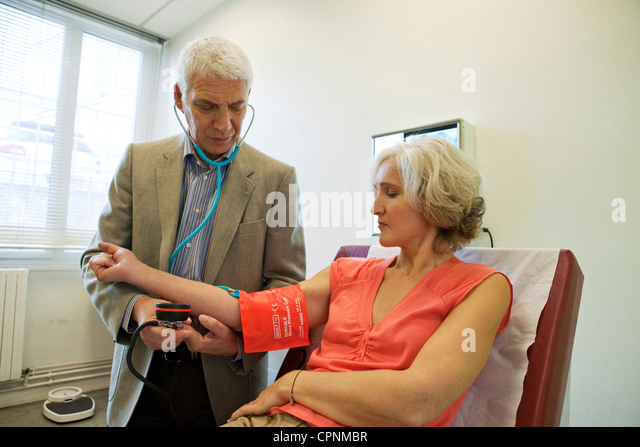 BLOOD PRESSURE, ELDERLY PERSON - Stock Image