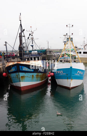 Athena M and Trevose, under 80ft inshore shellfish and hand liner fishing boats in Padstow, Cornwall, harbour. - Stock Image