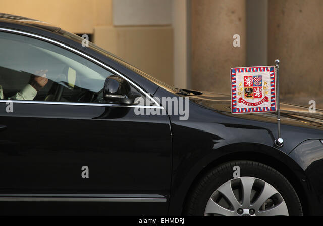Czech presidential limousine with a presidential standard drives ahead in Prague, Czech Republic. - Stock Image