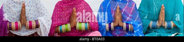 Indian girls namaste prayer hands panoramic - Stock-Bilder