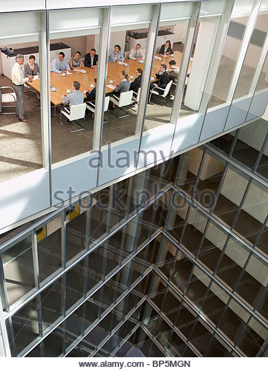 View of business people in conference room of highrise building - Stock Image