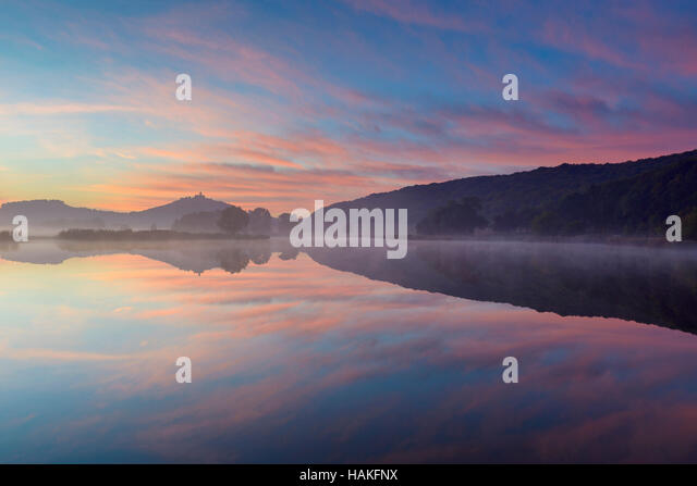 Landscape at Dawn with Wachsenburg Castle Reflecting in Lake, Drei Gleichen, Ilm District, Thuringia, Germany - Stock Image