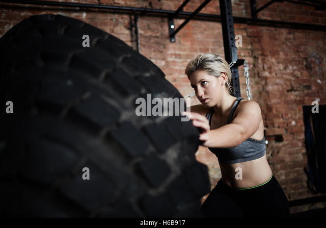 Exercise with tire - Stock-Bilder