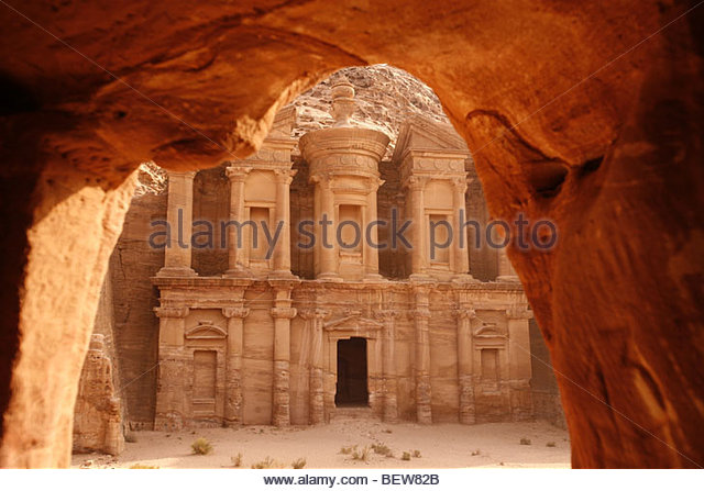 View from rock cave to the Al-Deir temple near Petra, the city in the rock, Jordan - Stock-Bilder