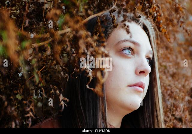 Portrait of a teenage girl looking sideways - Stock Image