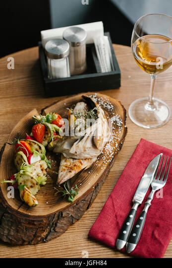 Fish and vegetables with white wine - Stock Image