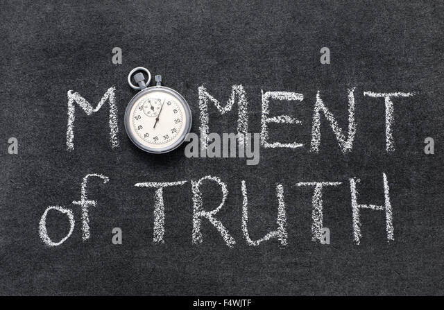 moment of truth phrase handwritten on chalkboard with vintage precise stopwatch used instead of O - Stock Image