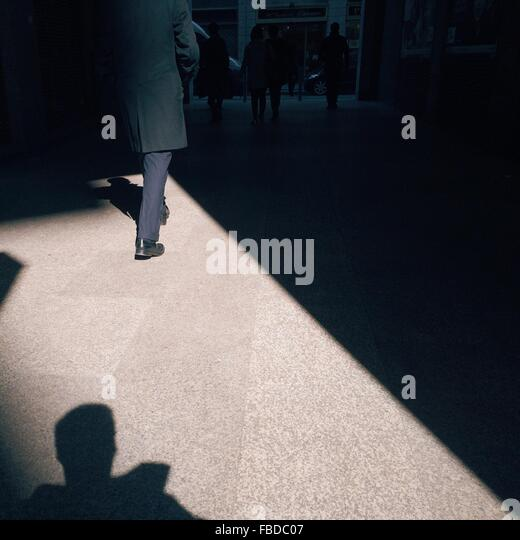 People Walking In City Street - Stock Image