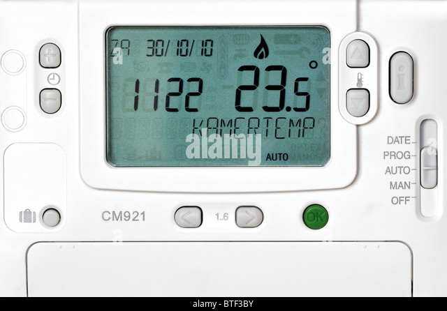 Different settings for thermostat of central heating - Stock Image