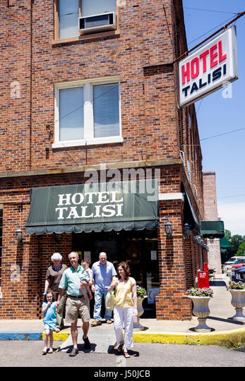 Alabama Tallasee Hotel Talisi man woman couple children girl boy grandparents family Southern historic downtown - Stock Image