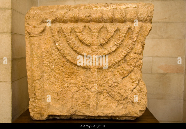 Stone relief bearing a carved figure of the Jewish Seven-Branched Menorah from 3rd-4th century CE at the Rockefeller - Stock Image