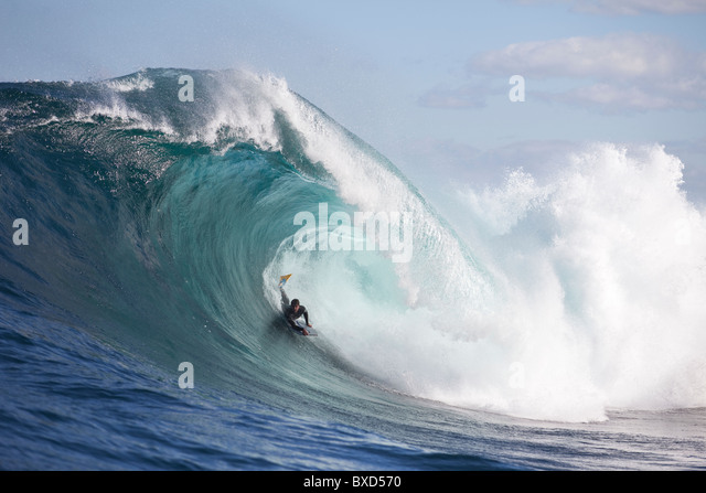 A surfer bodyboarding a dangerous wave at Shipstern bluff, in Tasmania. - Stock Image