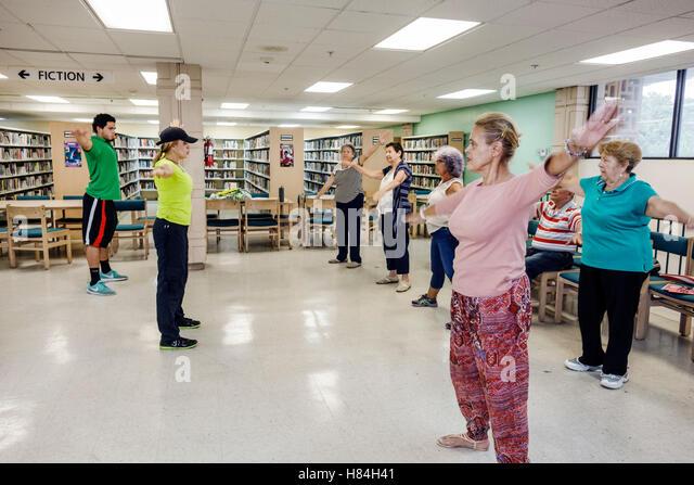 Miami Florida Hialeah JFK Library Health and Literacy Fair interior Hispanic woman exercise class - Stock Image