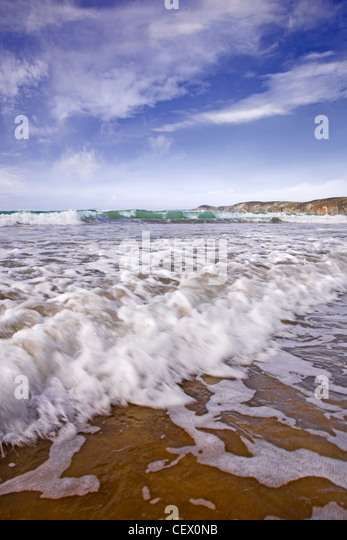 Waves rolling onto Newgale beach. - Stock Image
