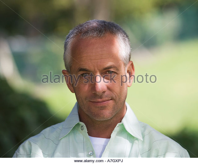 Portrait of a man with short grey hair, close-up - Stock Image