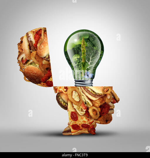 Diet ideas and dieting inspiration concept as an open human head made of greasy junk food with a lightbulb idea - Stock Image