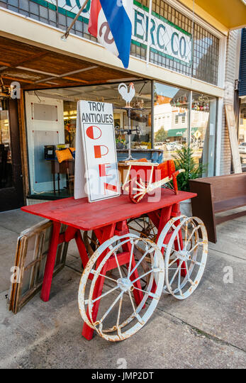 A sidewalk display for Troy Antiques, a small antique store on the main street of Troy, Alabama, typical of small - Stock Image