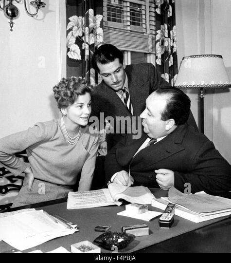 Alfred Hitchcock with Joan Fontaine and Laurence Olivier. - Stock Image