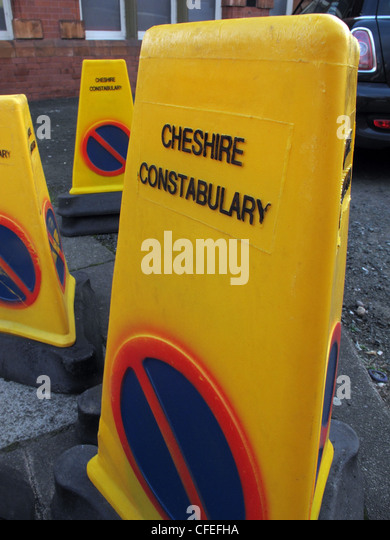 Yellow Cheshire Constabulary incident cones in road - Stock Image