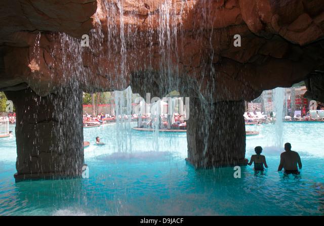 Nevada Las Vegas The Strip South Las Vegas Boulevard Flamingo Las Vegas Hotel and Casino swimming pool area sunbathers - Stock Image