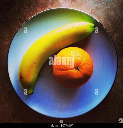 Plate of fruits top view - Stock Image