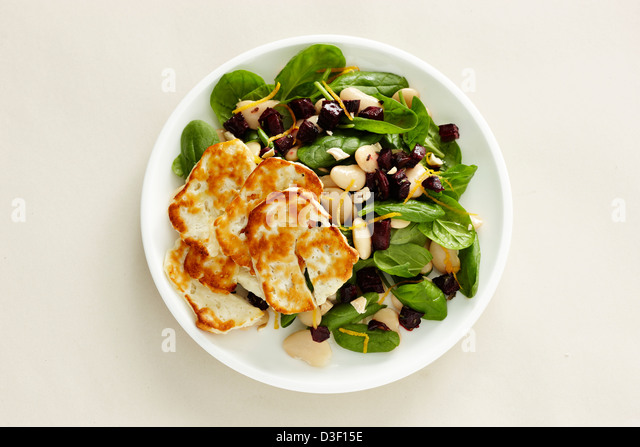 Grilled Halloumi butter bean beetroot spinach salad - Stock Image