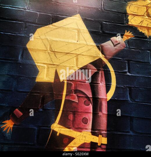 A mural shows a child with a square box covering his head in Colonia Roma, Mexico City, Mexico - Stock Image