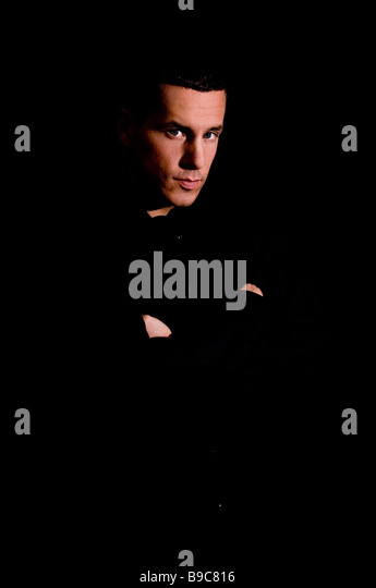 A studio portrait of a young Eastern European male - Stock Image