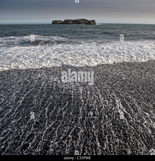Black sand beach with waves, Dyrholaey, Iceland - Stock Image