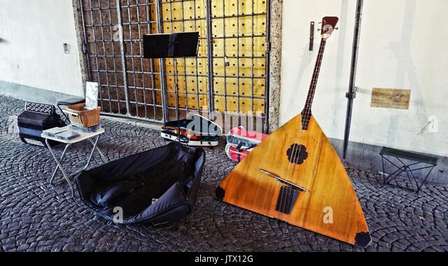 Musical instruments of street performer in downtown Munich, Germany - Stock Image