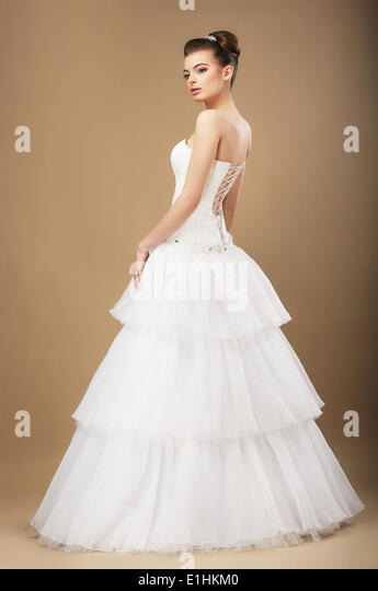 Full Length Portrait of Graceful Bide in White Wedding Dress - Stock Image