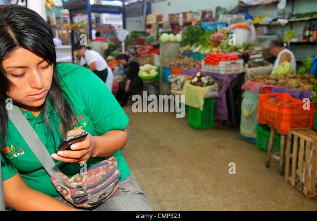 Lima Peru Surquillo Mercado de Surquillo market stall business shopping vendor produce vegetables fruit Hispanic - Stock Image