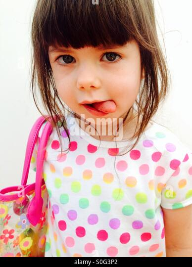 3-year old girl wearing colourful dress - Stock Image