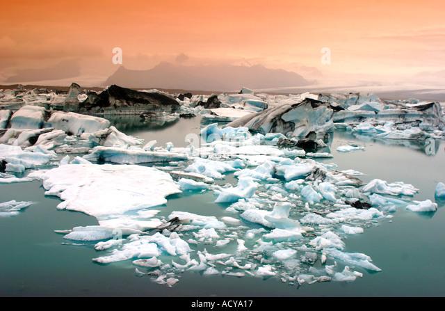 Iceland Jokulsarlon Glacial Lagoon Icebergs melting sunset near vulcano Jatnajoekull - Stock Image