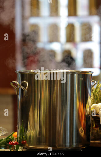 Steaming pot in a modern kitchen - Stock Image