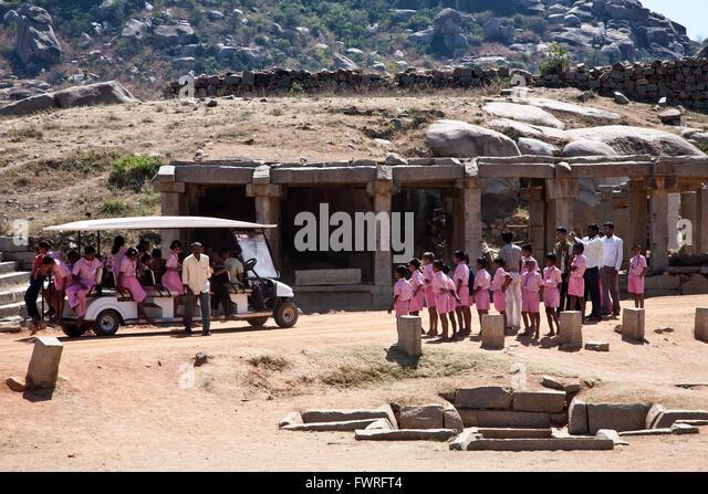 Indian scholars visiting a temple. Hampi. Karnataka. India - Stock Image
