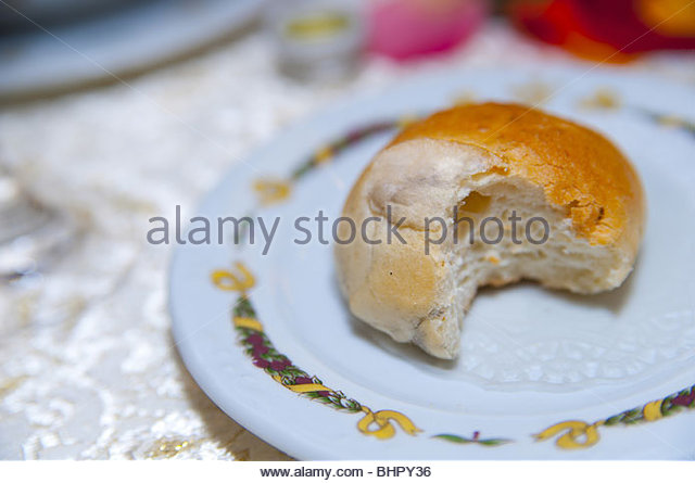 Bread bun with bite mark - Stock Image