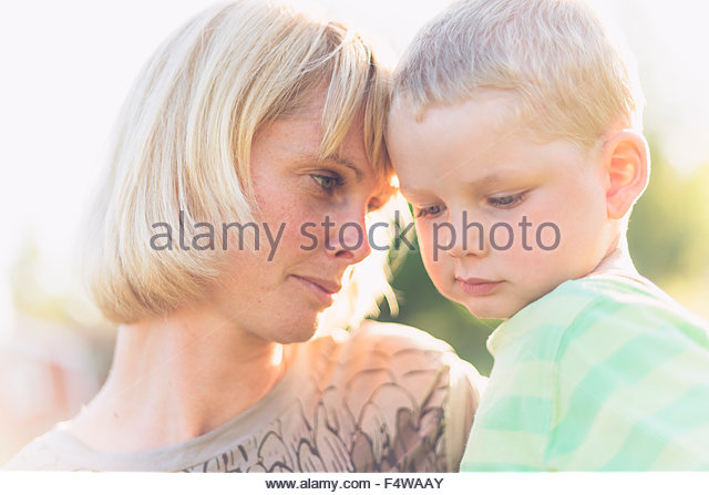 Portrait of mother and son (2-3) - Stock Image