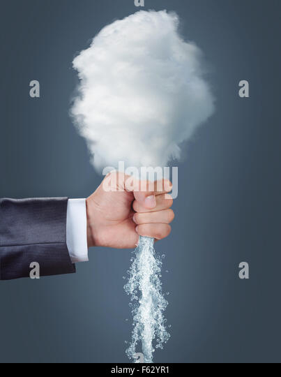 Male hand squeezing a cloud over grey background - Stock Image