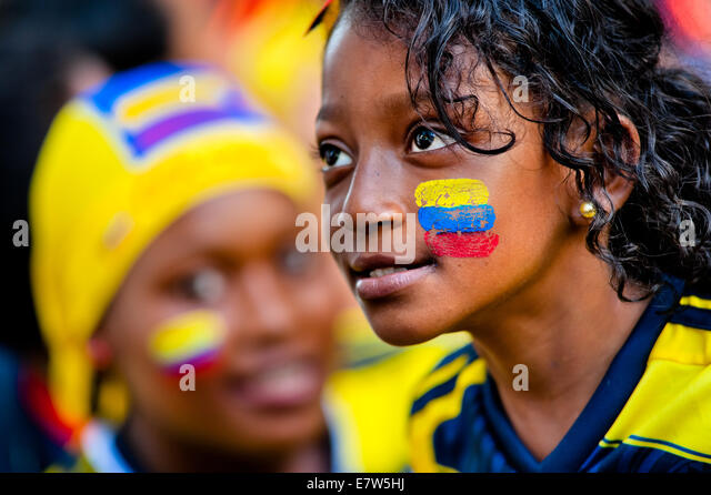 A Colombian girl watches the football match at the FIFA World Cup 2014, in a park in Cali, Colombia. - Stock Image