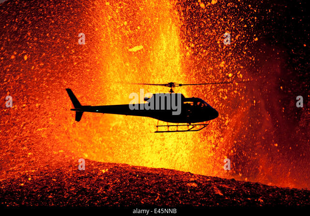 Helicopter flying over volcanic eruption near Eyjafjallajoekull glacier, Iceland, 24th March 2010. Volcano previously - Stock Image