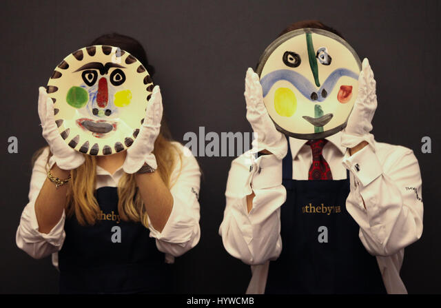 Sotheby's London, UK. 7th Apr, 2017. Members of Sotheby's staff holds Picasso's Ceramice Terre de faience - Stock Image