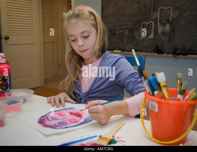 Child painting a portrait - Stock-Bilder