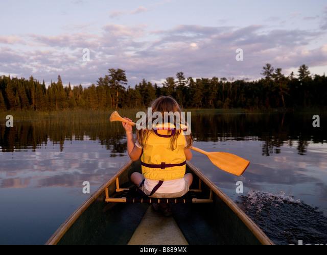 Girl in canoe - Stock Image