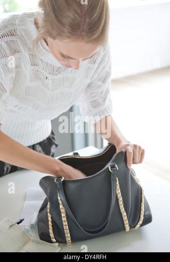 Woman Searching her Handbag - Stock Image
