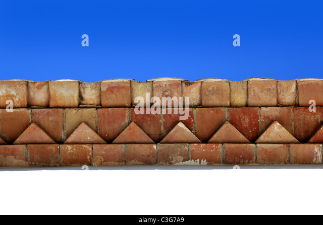 bricks roof eaves Mediterranean architecture detail traditional construction - Stock Image